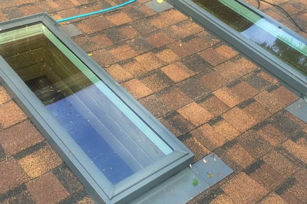 AFTER: skylight + roofing replacement